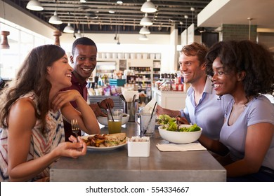 Friends Enjoying Lunch Date In Delicatessen Restaurant