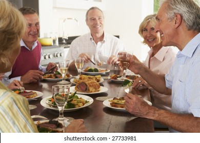 Friends Enjoying Lunch At Home Together
