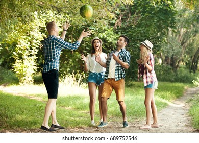 Friends is enjoying nature and playing with watermelon.