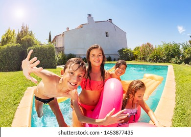 Friends enjoying outdoor pool party in summer