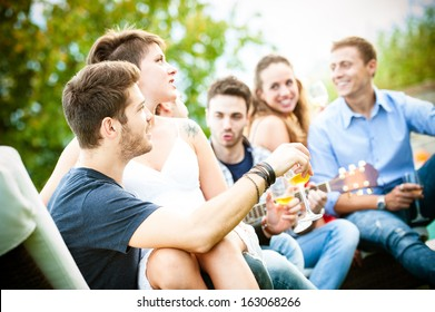 Friends enjoying at party - Stock Image