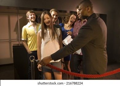 Friends entering a club.