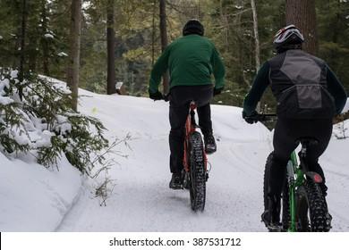Friends fat biking in winter