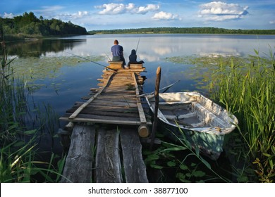 friends or father and son fishing on the lake