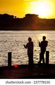 Friends Fishing Silhouette