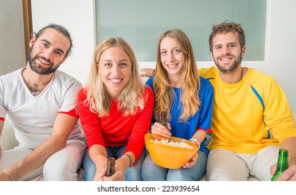 friends in front the television. football fans watching the match on tv