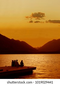Friends Gather on the Stehekin Dock, Lake Chelan, to Watch the Sunset