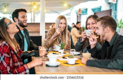 Friends group drinking cappuccino at coffee bar - People talking and having fun together at fancy cafeteria - Friendship concept with happy guys and girls at restaurant cafe - Warm bulb light filter