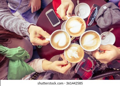 Friends group drinking cappuccino at coffee bar restaurant - People hands cheering and toasting on upper view point - Social gathering concept with men and women together - Vintage marsala filter