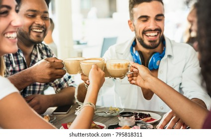 Friends group drinking latte at coffee bar restaurant - People talking and having fun together at fashion cafeteria - Friendship concept with happy men and women at cafe - Focus on cappuccino cups