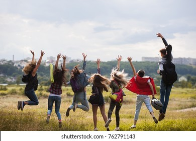 Friends group happy jumping nature concept. Tourist happiness. Active lifestyle.