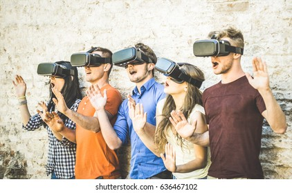 Friends group playing on vr glasses outdoors - Virtual reality and wearable tech concept with young people having fun together with headset goggles - Digital generation trends - Retro contrast filter