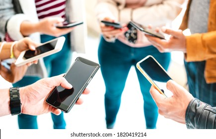 Friends group sharing content on mobile smart phone - Close up of people hands using tracking app with social media network - Technology concept with always connected millenials - Vivid bright filter