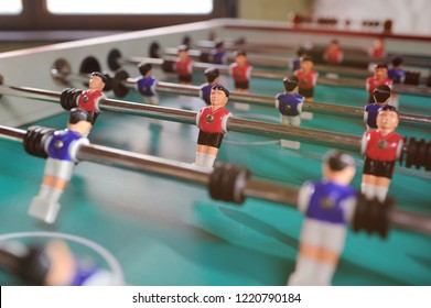 friends - guys and girls play table football.