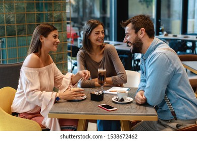 Friends hang out in a cafe