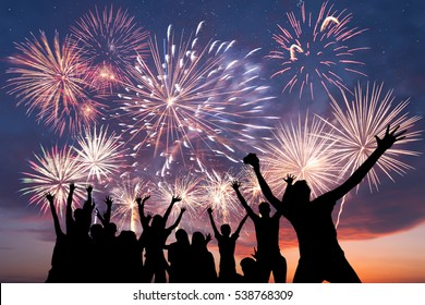 Friends are happy, looks holiday fireworks, people having fun