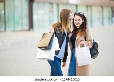 Friends are happy shopping, walking near shopping centers