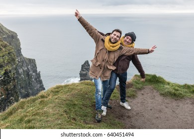 Friends have fun on vacation at the cliff of moher