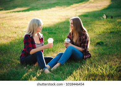 friends have fun in the park and drink smoothies at a picnic