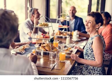 Friends having breakfast at a hotel