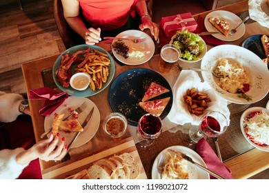 Friends having dinner for Christmas eve at home. Christmas holidays concept.