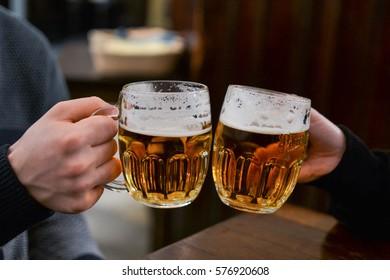 Friends having draught beer in Prague