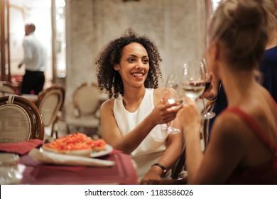 Friends having drinks in a restaurant.