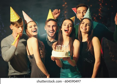 Friends having fun at birthday party in night club