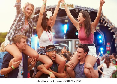 Friends having fun in the crowd at a music festival