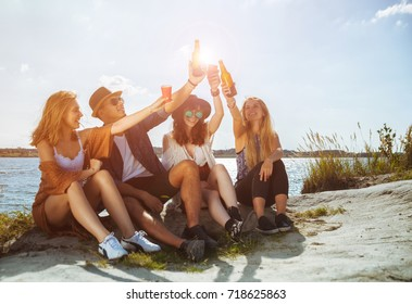 Friends having fun and drinking at the beach, freedom positive mood