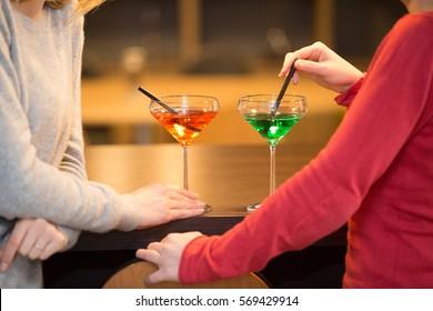friends having fun drinking cocktail