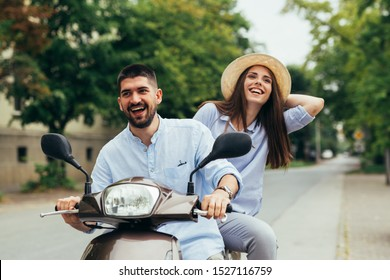friends having fun driving outdoor on scooter