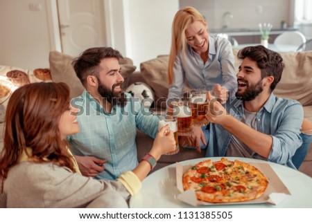 Friends Having Fun Homewatching Football Game Stock Photo Edit Now