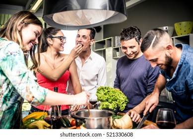 Friends having fun and making party at home