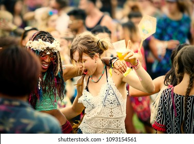 Friends having fun at a music festival