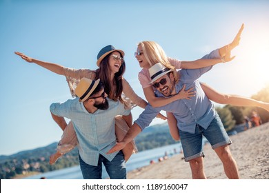 Friends having fun on the beach,enjoying together.