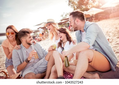 Friends having fun on the beach.Friendship,sea,summer vacation, holidays and people concept.