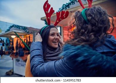 Friends Having Fun On Christmas Market