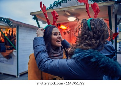 Friends Having Fun On Christmas Market