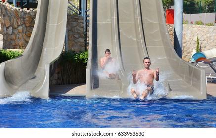 friends having fun on a water slide