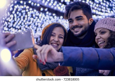Friends Having Fun Outdoors On Winter Market