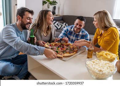 Friends having fun at party with delicious pizza.People sharing pizza. Let's the party begin.
