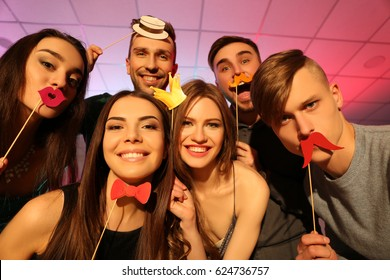 Friends having fun at party in night club