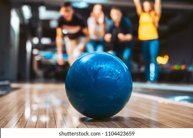 Friends having fun while bowling, selective focus