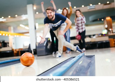 Friends having fun while bowling and spending time together