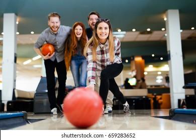 Friends having fun while bowling