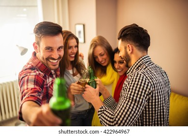 Friends having a great time while drinking beer.