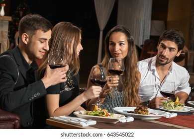 Friends having a nice dinner in a restaurant together