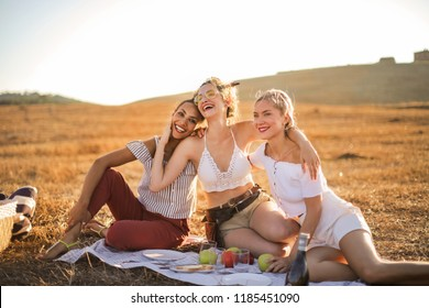 Friends having a picnic on the countryside.