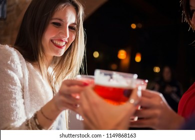 Friends having a round of drinks in a night club